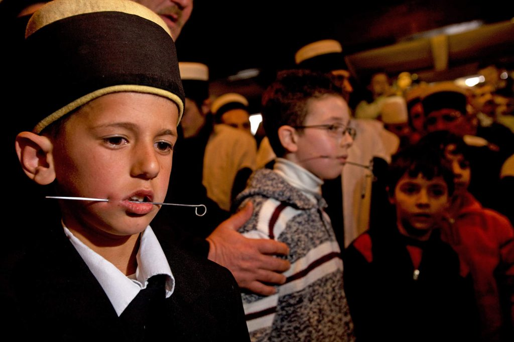 On the first day of spring, young dervishes in Kosovo are being pierced for the first time as they go through the initiation rite. This kid is seven year old.