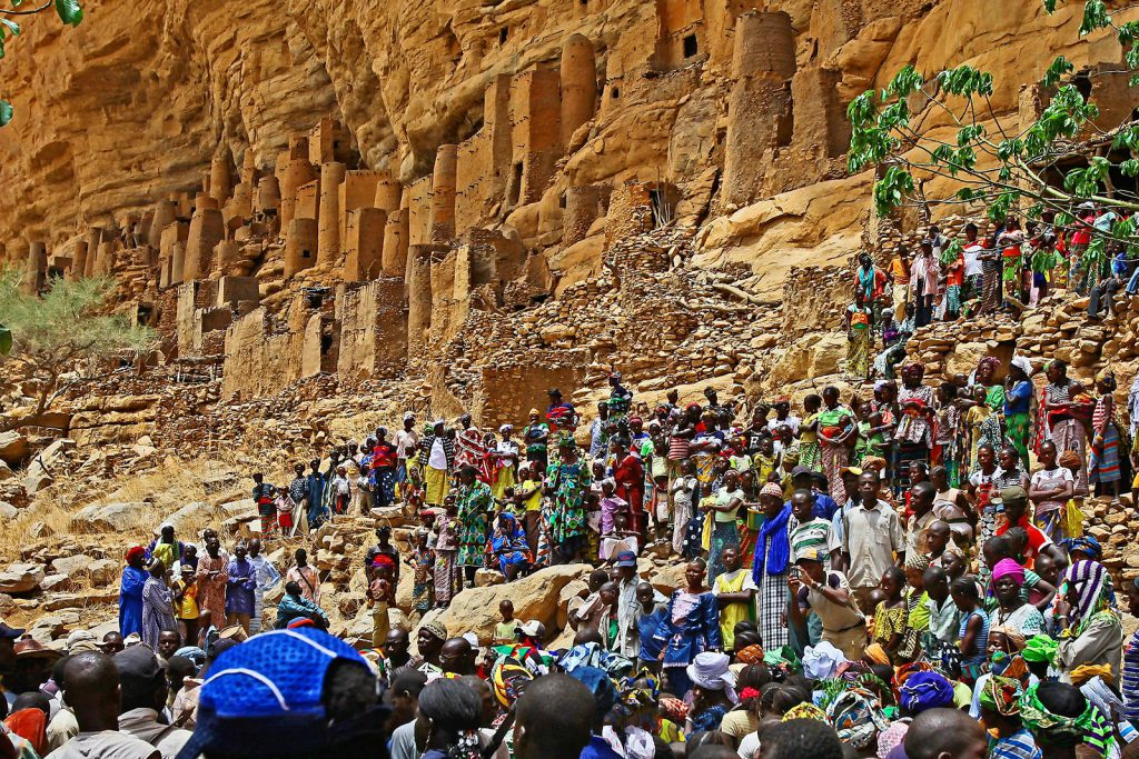 Their settlements are carved into cliffs, nestled in caves and spread along the foothills of the huge escarpment of Bandiagara.