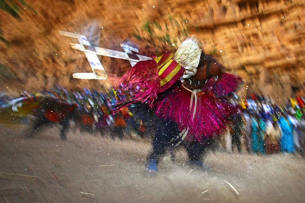 Masked dancers participate in all rituals that have anything to do with death.