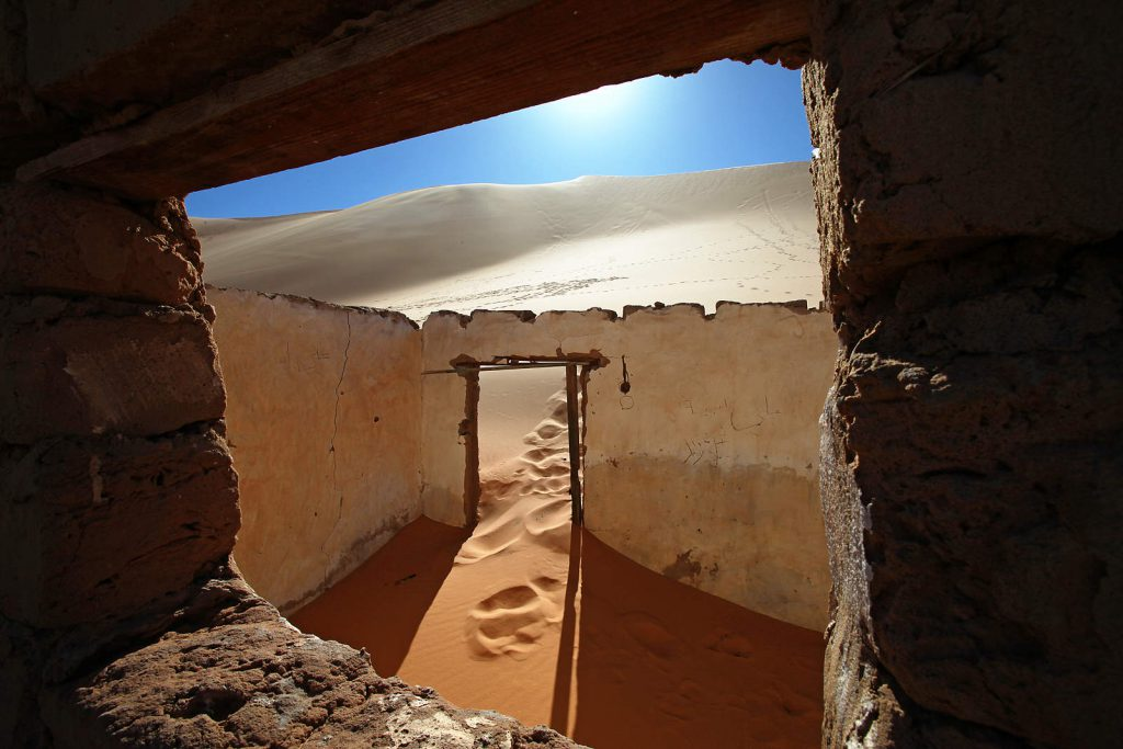 The desert has been swallowing the oasis villages ever since their inhabitants  had been relocated under Gaddafi's regime to newly built settlements