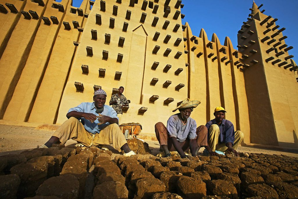 The Great Mosque in Djenne is the biggest structure in the world built from mud. Workers have to renew it every year.