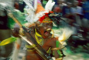 Sing-sing is a traditional celebration in Papuan tribal society. Influential chieftains - bigmen - gather entertainers who play music, dance and scare the odience with bows and arrows.